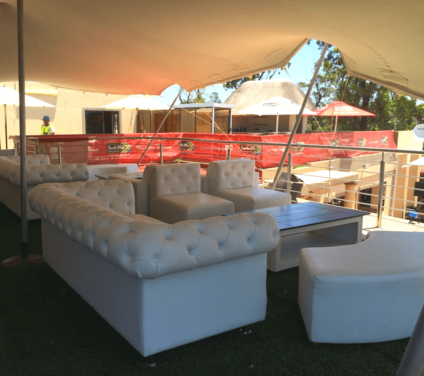 beige stretch tents with couches